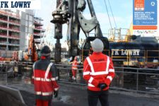 FK Lowry staff look up at the Piling Rig