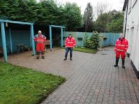 The Team show off their hard work, the tiled area has been scrubbed and power-washed